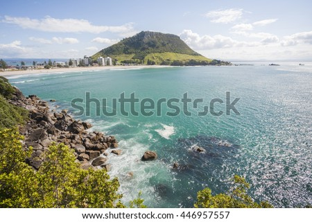 View of Mount Maunganui, Bay of Plenty, New Zealand, from Moturiki Island. The Mount, also known as Mauao, is an extinct volcano. - stock photo