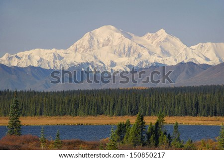 View of Mount McKinley, (Denali), looking west from the Parks Highway in Alaska. Denali is the tallest mountain in North America. - stock photo