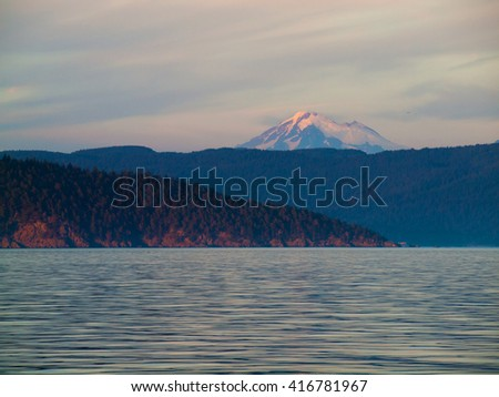 View of Mount Rainier at Sunset from a Boat - stock photo