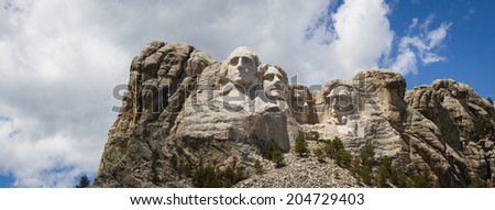 view of Mount Rushmore National Monument on a spring morning with some clouds and sunshine - stock photo