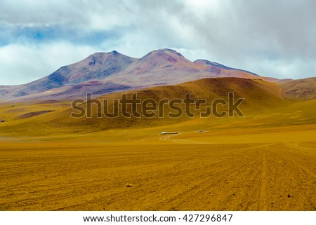 View of mountain and desert in Salar de Uyuni, Bolivia - stock photo