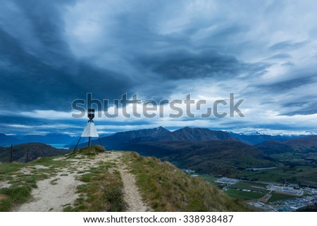 view of mountain and dramatic clouds at sunset in Queenstown, New Zealand - stock photo