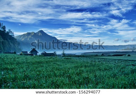 View of Mountain and Paddy Field in Bali Indonesia - stock photo