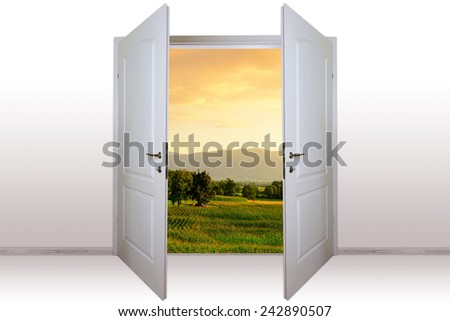 view of mountain landscape through open door - stock photo