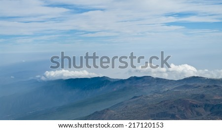 view of mountain range and clouds in el teide national park, tenerife, spain - stock photo
