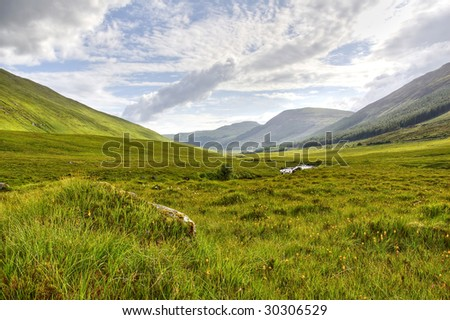 View of mountains and meadows Isle of Skye in Scottish Highland in HDR - stock photo