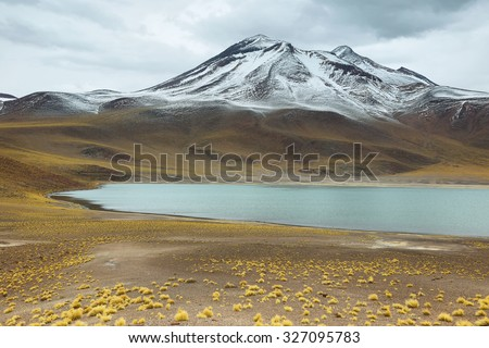 View of mountains and Miscanti lagoon in Sico Pass, Chile - stock photo