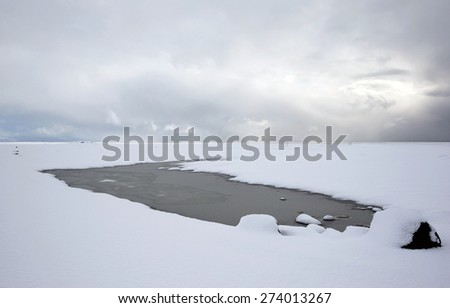 View of mountains, snow covered plains and rivers in southern Iceland during winter. - stock photo