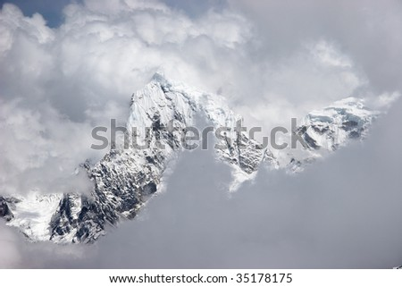 View of mountains through holes in clouds, Himalayas - stock photo