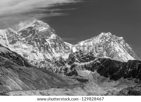 View of Mt. Everest (8848 m) and Lhotse (8516 m) from the Ngozumba Tsho ( the fifth Gokyo lake ) - Nepal, Himalayas (black and white) - stock photo
