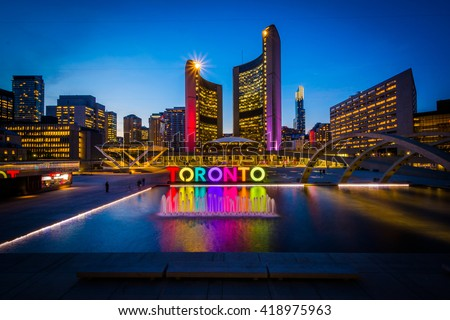 View of Nathan Phillips Square and Toronto Sign in downtown at night, in Toronto, Ontario. - stock photo