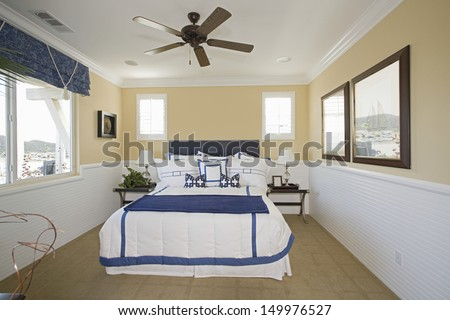 View of nautical themed bedroom at a home - stock photo
