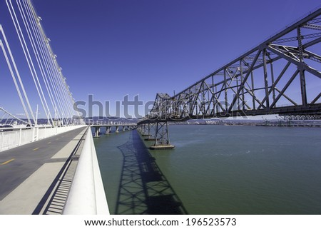 View of new and old spans of Bay Bridge, connecting Oakland and San Francisco, California - stock photo