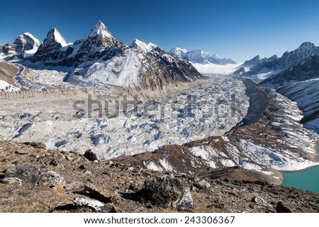 View of Ngozumba glacier, the largest glacier in great Himalayan range - way to Cho Oyu base camp - Nepal  - stock photo