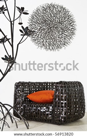 View of nice modern twiggen chair on white back - stock photo
