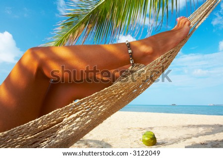 view of nice smooth woman's legs in tropical bliss - stock photo