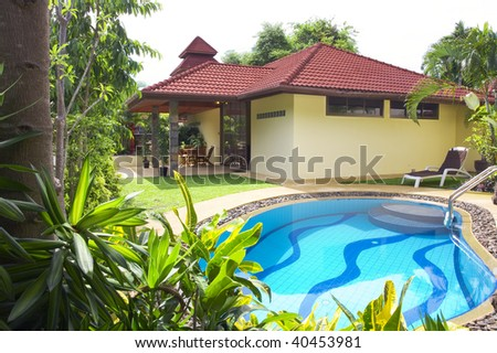 View of nice summer house  in  tropic environment - stock photo