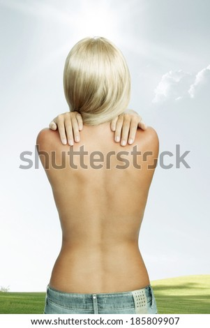 View of nice young woman back on color back - stock photo
