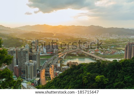 View of of Taipei city with highway by the sunset - stock photo