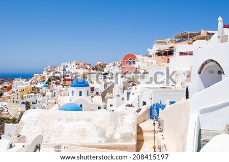View of Oia with typical white and blue painted houses on the island of Santorini,Greece. - stock photo