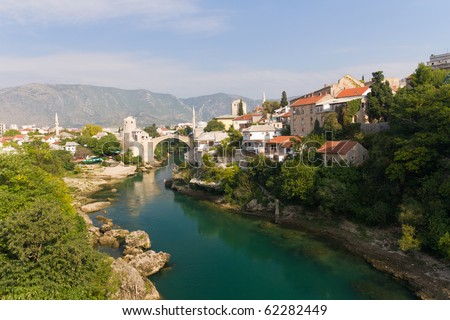 View of Old Bridge on the Neretva River in Historic Mostar, Bosnia and Herzegovina - stock photo