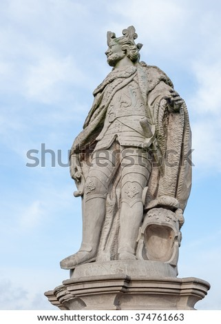 "View of one of the ancient statues on the historic bridge ""Alte Mainbruecke"" of Wuerzburg in Bavaria - stock photo"