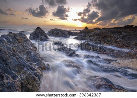 View of Pandak Beach in Malaysia during sunset with slow shutter technique - stock photo