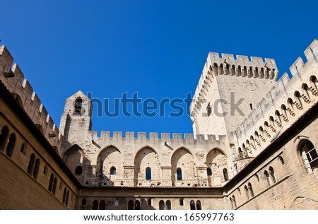 View of Papal Palace (Palais des papes d'Avignon, circa 1370) from inner yard. UNESCO World Heritage Site. Avignon, France - stock photo