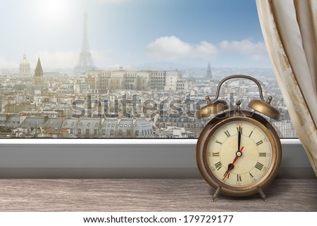 View of Paris and Eiffel tower from window with alarm clock - stock photo