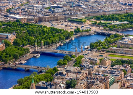 View of Paris, Pont Alexandre III, Luxor Obelisk and Place de la Concorde from from the Eiffel tower - stock photo