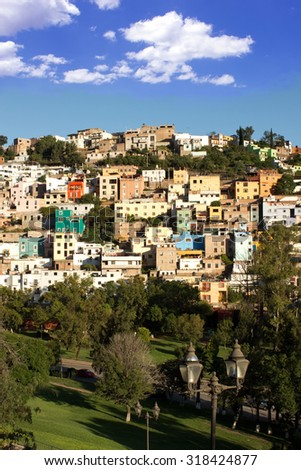 View of Park and Hillside Housing in Guanajuato, Mexico on Sunny Afternoon - stock photo