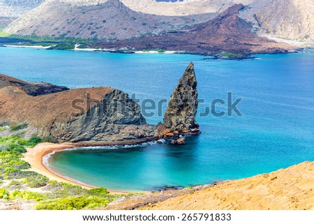 View of Pinnacle Rock on Bartolome Island in the Galapagos Island in Ecuador - stock photo
