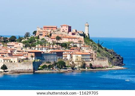 ... falcone and theLighthouse. Isle of Elba, Livorno, Italy. - stock photo