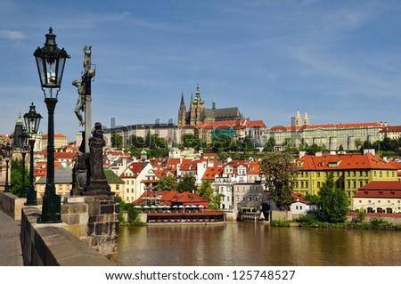 View of Prague castle and Charles Bridge - stock photo
