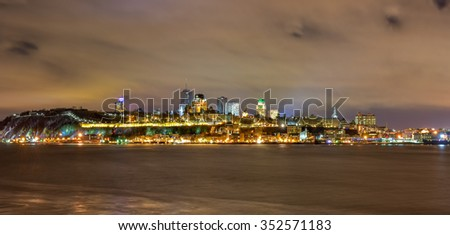 View of Quebec City, Canada from Levis at twilight with a view of the ramparts surrounding the old city. - stock photo