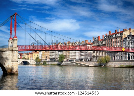 View of red footbridge in Lyon with Saone river,France - stock photo