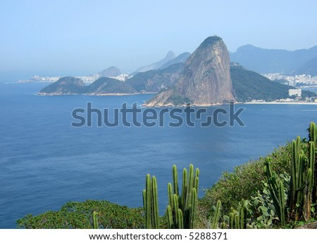 View of Rio de Janeiro city entrance, showing the Sugar Loaf and Copacabana beach in the background - stock photo