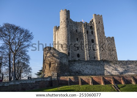 View of Rochester Castle in Kent, showing one of the best preserved Norman tower or keep in England. The castle was founded in 1127 and is visited by thousands of  tourists each year. - stock photo