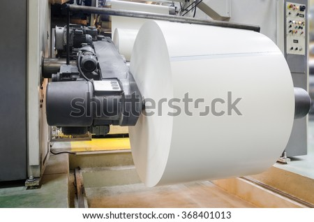 View of rotation machine in Printing house. Part of machine that is called the star, it changes rolls of paper continuously - stock photo