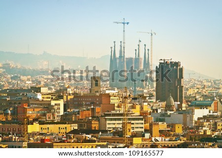 View of Sagrada Familia in scaffolding on the background of the morning (Barcelona, Spain, Europe) - stock photo
