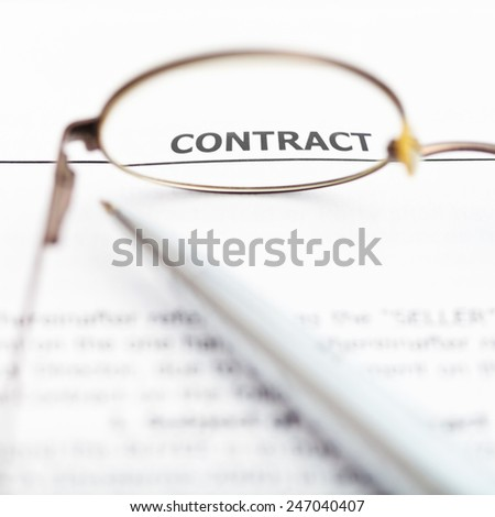 view of sales contract through eyeglasses close up - stock photo
