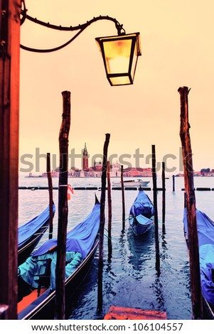 View of San Giorgio maggiore with gondolas. From San marco. - stock photo