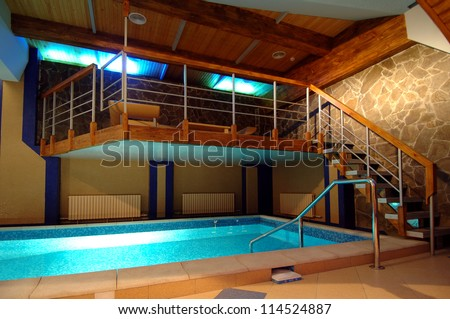 view of screened in swimming pool and lanai with sitting area - stock photo