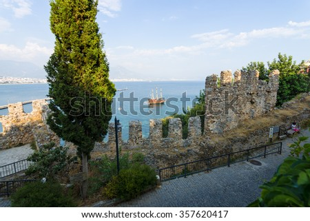 View of sea port of Alanya. In the foreground the ruins of an ancient fortress. Turkey. - stock photo