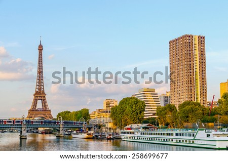 View of seine river and Eiffel tower in Paris, France. Paris transportation - stock photo