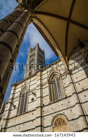 View of Siena Cathedral Tower through Arch - Siena, Tuscany, Italy - stock photo