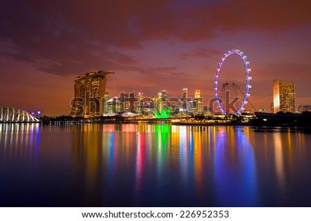 View of Singapore city skyline at sunset - stock photo