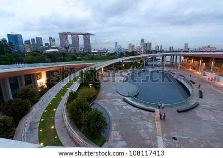 View of Singapore's skyline from Marina Barrage at dusk - stock photo