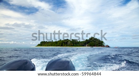 View of Sipadan Island from a Diving Speedboat! - stock photo