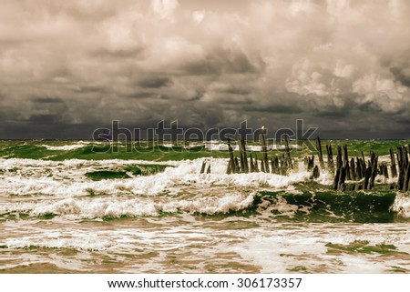 View of sky and sea on a stormy seashore  - stock photo